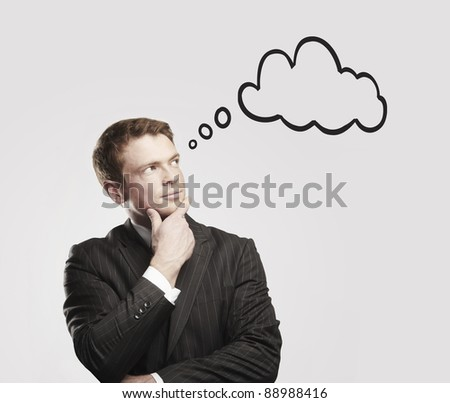 Young businessman with speech bubbles inside. Thinking man. Conceptual image of a open minded man.On a gray background
