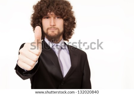 young businessman with thumb up isolated on white background