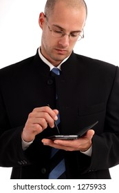 Stock photo of a young businessman working on handheld