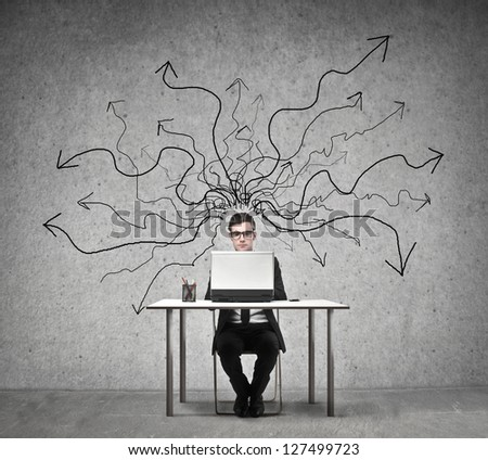 young businessman working at desk with laptop