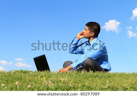 young businessman working at the park