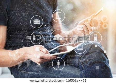 Young businessman working on a laptop and illustration infographics #1500657761