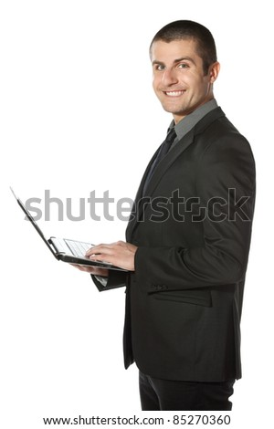 Young businessman working on laptop over white background