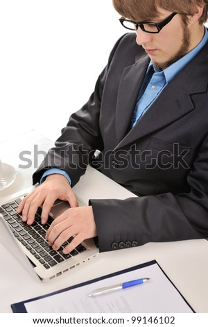 Young businessman working with laptop