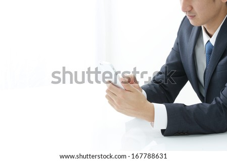 Young businessman working with modern devices