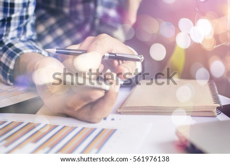 Young businessman working with modern devices, digital tablet computer and mobile phone. #561976138