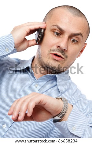 Young businessman worried looking at his wrist watch