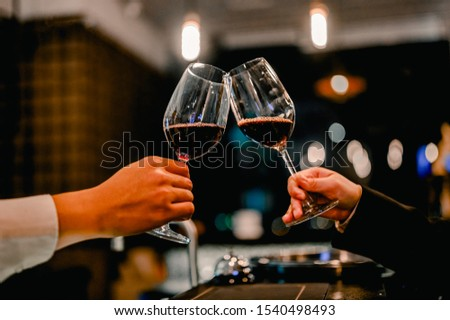Young businessmen and women are drinking wine to celebrate the night of new business success together. Togetherness Concept.