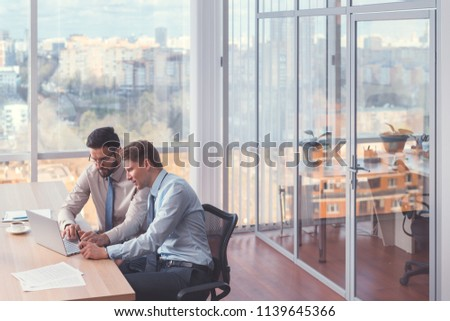 Young businessmen at a meeting in the office #1139645366