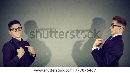 Young businessmen pretending and blaming each other in lie.