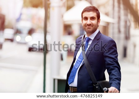 Young businessmen with a bike #476825149