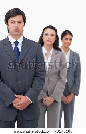 Young businesspeople standing in line against a white background