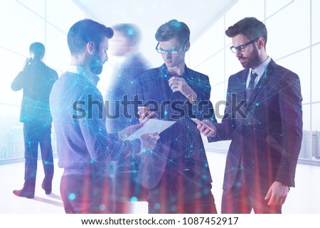 Young businesspeople standing in modern office interior with sunlight and polygonal patter. Toned image. Teamwork, meeting and technology concept. Double exposure  #1087452917