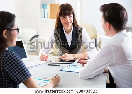 Young businesspeople working with laptop in office #608703923