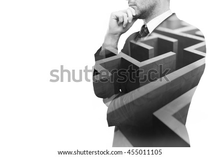 Young businessperson thinking about ways to overcome business obstacle. Isolated on white background with maze and copy space. Double exposure #455011105