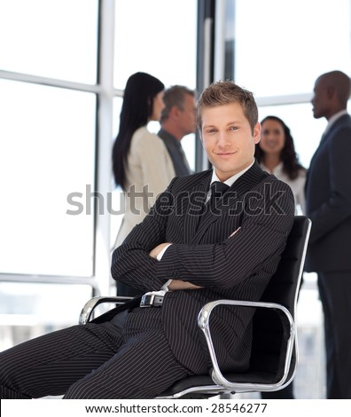 Young Businesssman in office sitting on chair