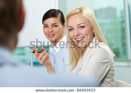 Young businesswoman addressing her colleague