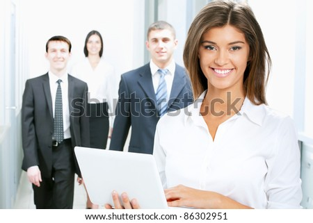 Young businesswoman and her colleagues