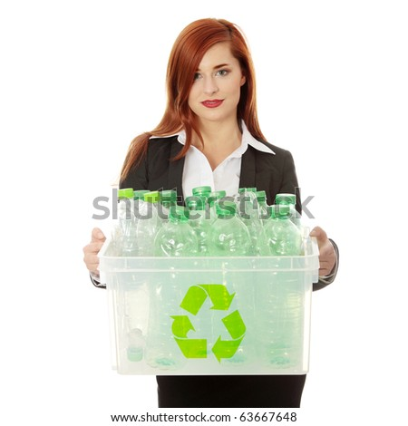 Young businesswoman carrying a plastic container full with empty recyclable household material. Recycling concept