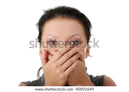 Young businesswoman covering her mouth with hands
