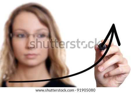 Young businesswoman drawing a chart on white