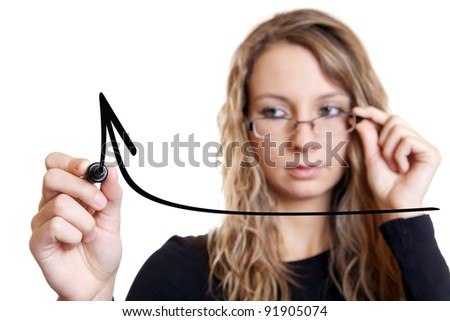 Young businesswoman drawing a graph on white, focus on pen