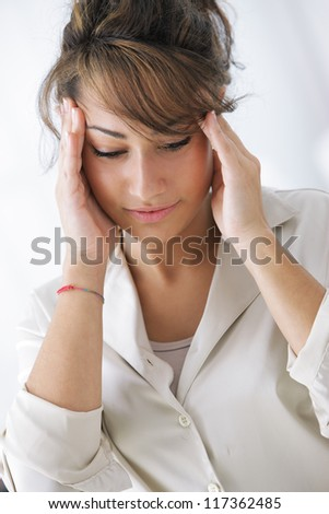 Young businesswoman has a headache