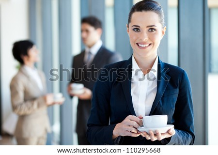 young businesswoman having coffee break at work