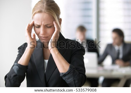 Young businesswoman having headache, stress at workplace, feeling ill, finance problem. Office female overworked, difficult decision, negotiating fears, depressed, forgot, made error, pretending sick