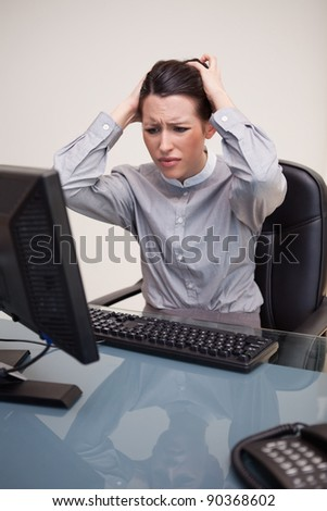 Young businesswoman having problems with her computer