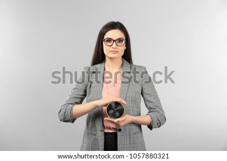 young businesswoman holding...