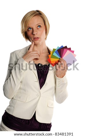 Young Businesswoman holding color swatches isolated on a white background