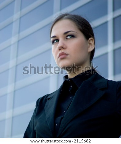 Young businesswoman in front of a modern office building