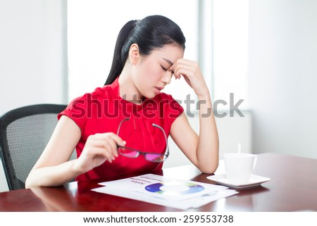young businesswoman in her office, asia girl.