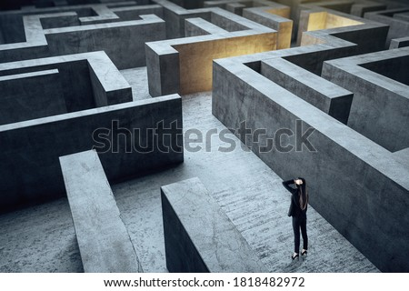 Young businesswoman in suit standing in maze. Business and challenge concept. Foto d'archivio ©