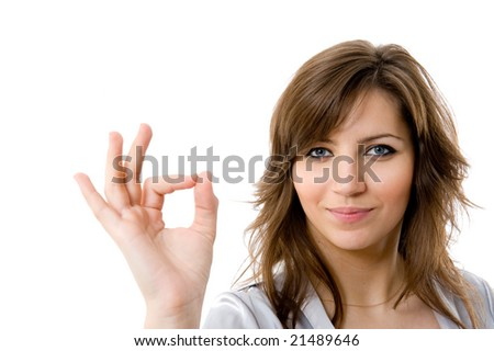 Young businesswoman indicating ok sign. Isolated over white background