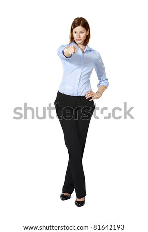 Young businesswoman isolated on a white background standing and pointing ahead as she wants you