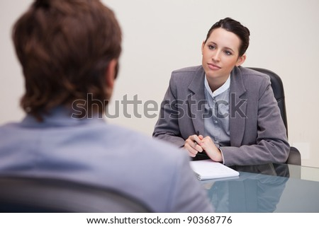 Young businesswoman listening to her business partner