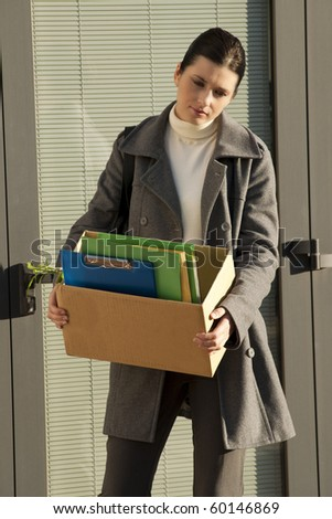 Young businesswoman losing her job due to corporate downsizing