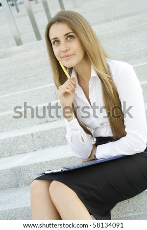 Young Businesswoman lost in thought over the signing of the document. Analyzes