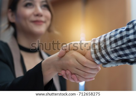 Young businesswoman make handshake with a businessman in succes business concept