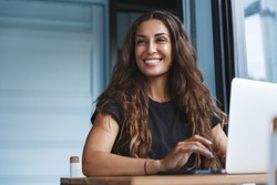 Young businesswoman manage business from home on remote, freelancer using laptop sit kitchen table on self-quarantine, work over personal growth, apply for online courses to learn new skills