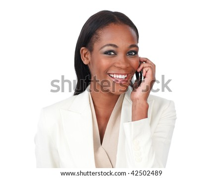 Young businesswoman on phone smiling at the camera against a white background