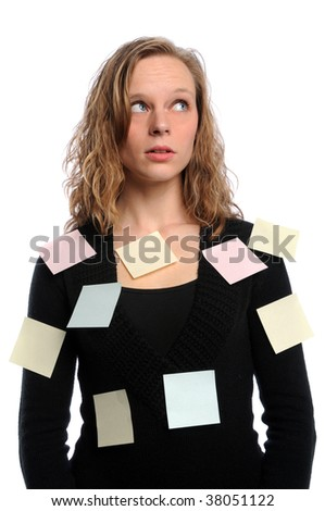 Young businesswoman overwhelmed with adhesive notes