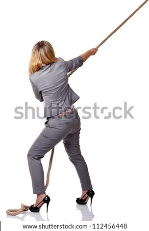 young businesswoman pull rope isolated on white
