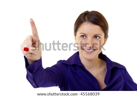Young businesswoman pushing or pointing a transparent screen isolated on white background - stock photo
