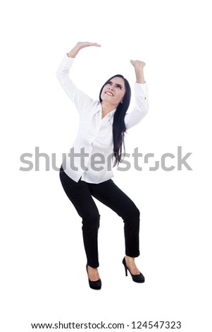 Young businesswoman pushing something, isolated over white