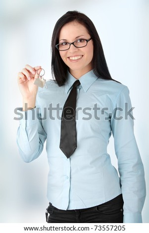 Young businesswoman  (real estate agent) with key