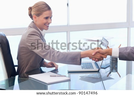 Young businesswoman receiving a customer in her office