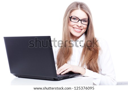 Young businesswoman, secretary or student working on laptop,wearing glasses and white business shirt isolated